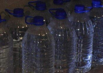 10 тысяч бутылок с подозрительной жидкостью нашли у казахстанца 1